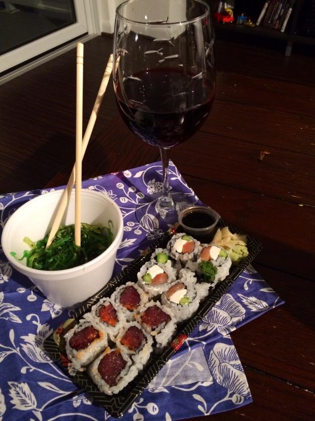 Spicy tuna roll, smoked salmon roll, and seaweed salad